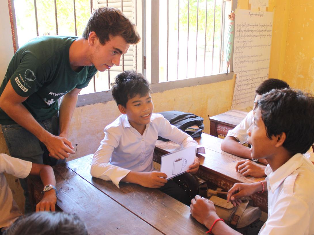 Teaching intern talks his students through a classroom activity in Cambodia.